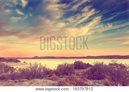 Nature scenery in retro style.Lake and vegetation in vintage effect.Landscape and blue sky,vintage effect