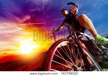 Sport and healthy life.Mountain bike and sunset. Sport and healthy life.Mountain bike and landscape background