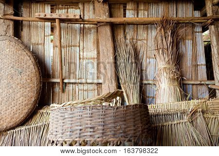 Travel around the world. Bamboo tribe home background.Exotic travels and adventures .Thailand trip.Tribe utensils and cabin