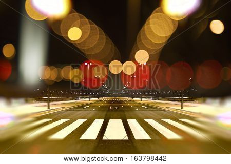Empty street city at night and lamp post light flares.Road background