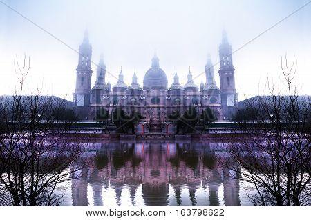 Zaragoza cityscape.Basilica.Winter and fog over the river