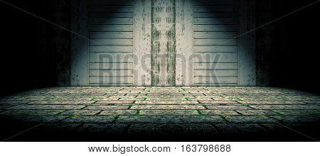 Wood door and cement floor background.Spotlight in the street