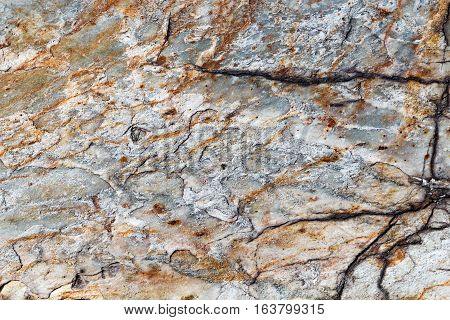 Texture Of Stone Or Marble With Brown Streaks With Deep Cracks On The Left Side