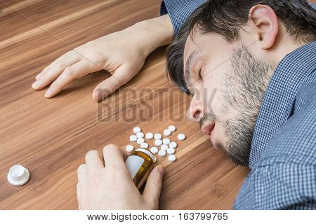 Suicide Attempt. Man Is Lying On Table After An Overdose Of Pill
