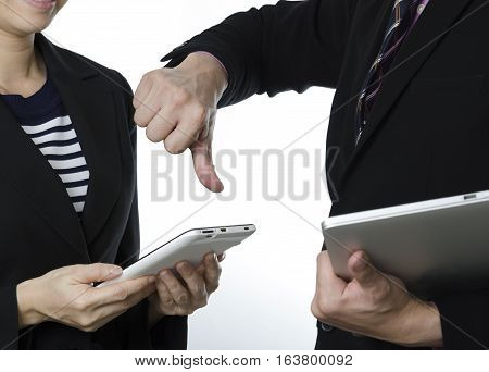 Business failure businessman gesturing a thumbs down in displeasure to partner.
