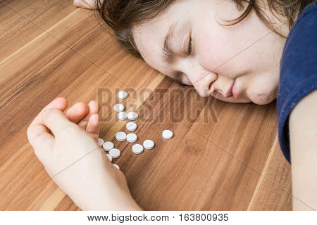 Young Woman Is Lying On Table. Suicide Attempt By Overdose Of Pi