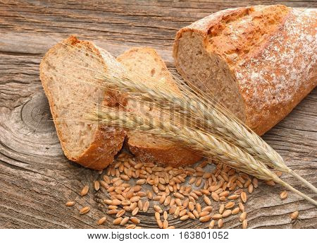 resh bread and wheat on the wooden