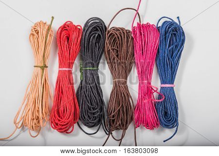 Multi colors of thread or cord rolled up
