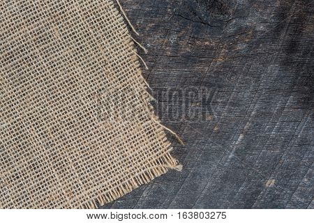 Burlap napkin laying on an olden wooded board