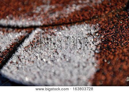 Asphalt shingles are frosted. Roof Frostbitten. Deteil.