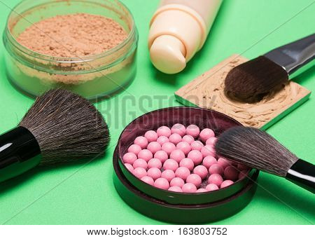 Basic makeup products to create beautiful complexion: foundation, powder, blush with makeup brushes