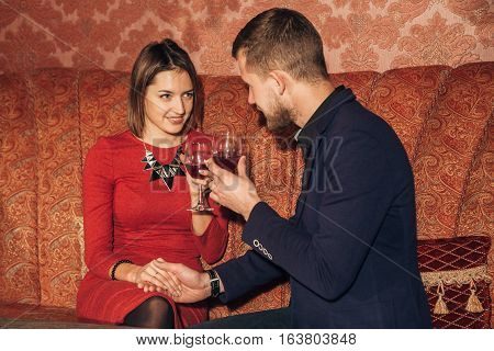 young couple flirting in the restaurant on a date. first date, love