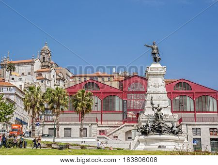 Statue of Prince Henry - navigator in the eponymous square is located in the historic center of Porto near the New Exchange building the promenade the church of St. Francis and St. Nicholas shops and cafes .