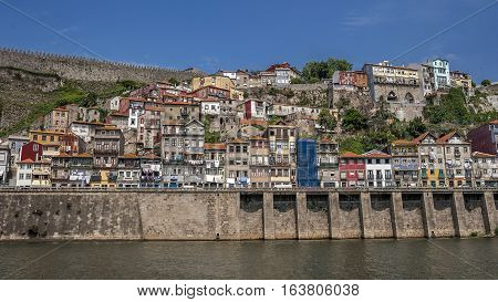 Portugal Porto the embankment of Duero river residential quarters of the old town on the balconies drying clothes . The fortress wall .