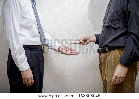 Man Paying  A Hryvnia Bribe To A Corupted Nan Accepting It