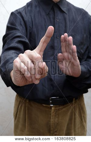 A Man Saying No With A Finger Gesture