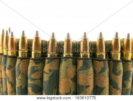 Camouflage ammunition belt for rifle on white background.