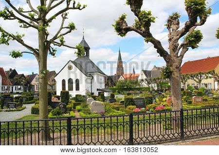 Schleswig Germany-may 21 2008:Old cemetery in the centre of the fishing village of Hill