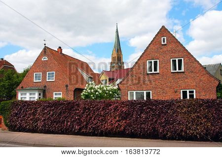 Schleswig Germany-may 21 2008:Street of the old town with small houses with tiled roofs. Fishing village the Hill