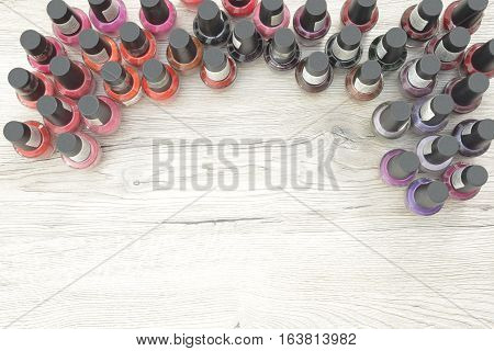 Nail polish placed on a wood table with room for text
