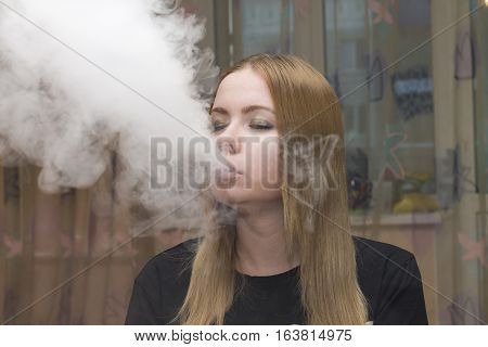 vape girl in the black dress smoking electronic cigarette