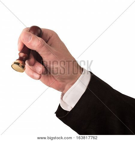 front view of male hand with black suit and white shirt holding a personal stamp tool with wooden handle and metallic empty head isolated on white