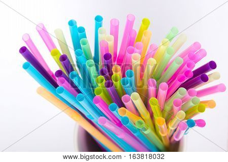 Colorful plastic drinking straws - copy space