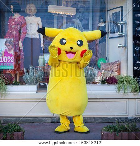 KIEV UKRAINE - SEPTEMBER 17 2016: Happy Pokemon Pikachu mascot near shop showcase in Kiev Ukraine.
