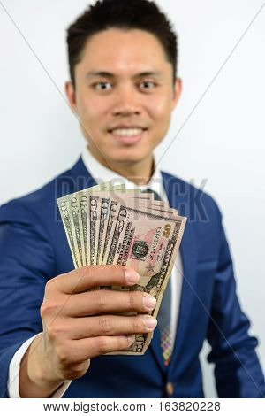 Hand Carrying Currency Note Spread Out