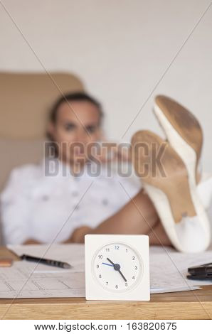 Woman refusing to work late hours at the office
