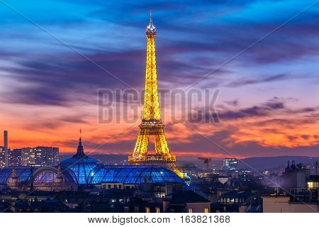 Paris, France - January 3, 2017: Aerial view of Shimmering Eiffel tower Light Performance Show at night in the New Year. Eiffel Tower - a symbol of Paris, the most visited and photographed landmark.