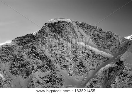 Black And White View On Mountains With Snow In Winter Sun Evening