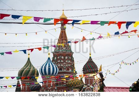 Moscow, Russia - December 29, 2016: Flags and lights in front of the Cathedral of Vasily the Blessed in Moscow in New Year holidays