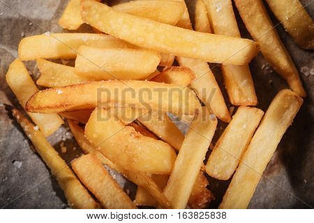 Tasty and fried. Top view of delicious French fries being served in restaurant on a table.