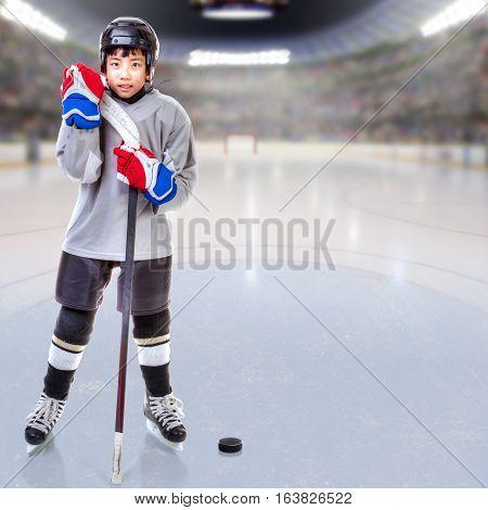 Junior Ice Hockey Player Posing In Arena