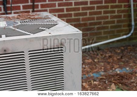 Air conditioning unit outside of red brick building