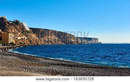 Almeria skyline and rocky coastline. Southern Spain.
