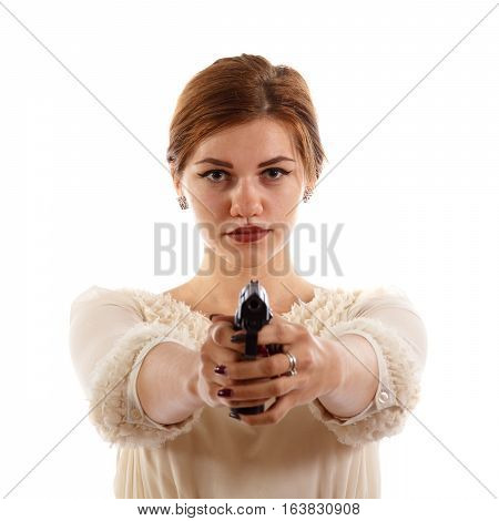 A lady in a white dress holding a handgun