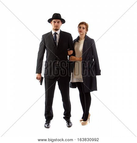 A lady with a man holding a pistol
