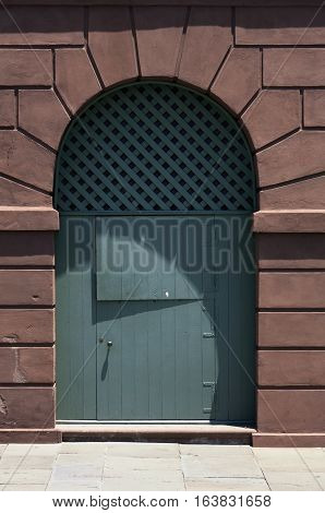 The arched shaped Voussoir stones over a door at the historic Slave Market in Charleston, South Carolina