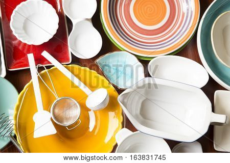 Various colorful dishes and utensils as background