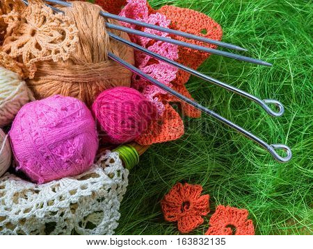 colorful balls of colored wool for knitting in the basket