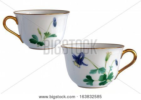 Two antique porcelain cups Flowers of Aquilegia isolated on white background