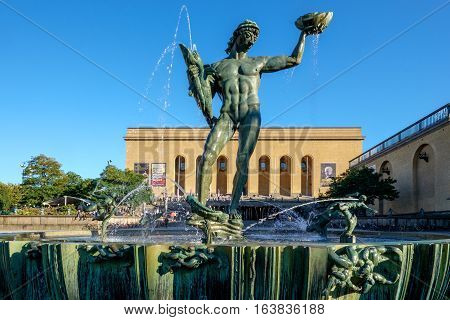 GOTHENBURG - SEPTEMBER 4, 2014: The iconic statue of Poseidon at Gotaplatsen in Gothenburg. This sculpture by Carl Milles has become a symbol for Gothenburg.