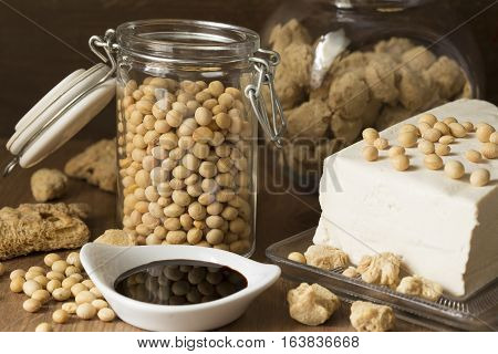 Soy products on wooden background - close up