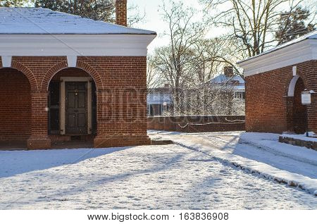 Charlottesville, USA - January 24, 2013: Snowfall on lawn of University of Virginia dormitories during winter storm