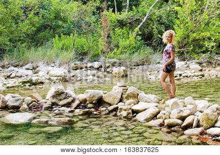 Young woman walking in Barton Creek Greenbelt in Austin Texas