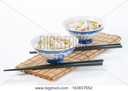 Two bowls of hot and delicious wonton soup.