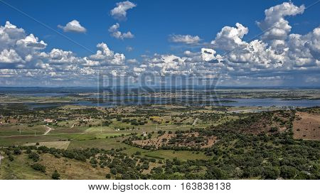 Portugal the District of Evora. Monsaraz. From the castle walls overlooking the small town cemetery and then to neighboring Spain and Guadianu River a natural border of Spain .