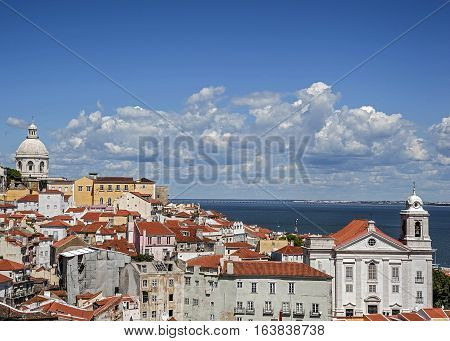 Portugal Lisbon . The observation deck Portas do Sol - a view of the old district of Alfama with its winding streets the Church of São Vicente de Fora and the Tagus River.